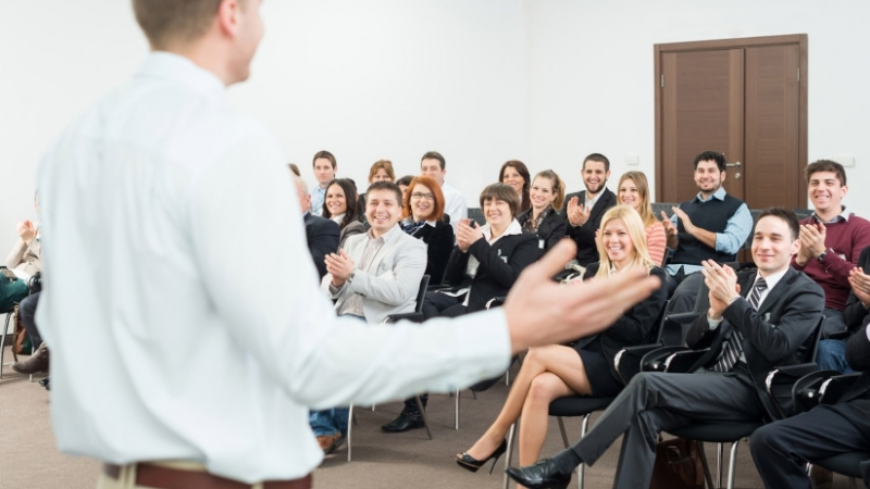 09-01-14-Presentation-Skills-stock-photo-23486800-young-people-applauding-to-a-seminar-presenter1
